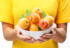 Crockery with mellow apricots. Royalty Free Stock Images