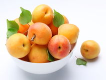 Crockery with mellow apricots. Royalty Free Stock Photo