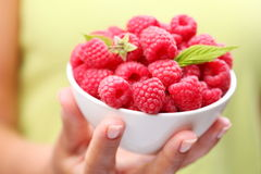 Crockery with raspberries Stock Photo
