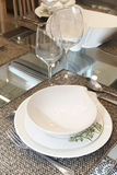 Crockery set over a table ready to be served Royalty Free Stock Photo