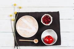 Crockery set with red pomegranate.  Flat lay Royalty Free Stock Photo