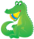 Crocodile. Isolated clip art of a green crocodile swallowing a big ball Royalty Free Stock Photo