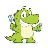 Crocodile or alligator holding toothbrush and toothpaste Stock Photo