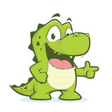 Crocodile or alligator pointing. Clipart picture of a crocodile or alligator cartoon character pointing Stock Photo