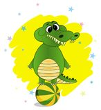 Cartoon Crocodile with a ball on the white background stock illustration