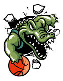 Crocodile basketball mascot break the wall Stock Photos