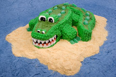 Crocodile Cake. A fun children's cake - an alligator or crocodile on a sandy island in the middle of the water Stock Photography