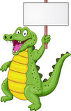 Crocodile cartoon with blank sign Royalty Free Stock Photos