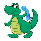 A crocodile with cell phone Royalty Free Stock Photography