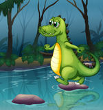 A crocodile crossing the pond Stock Images