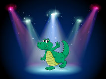 A crocodile dancing in the middle of the stage Royalty Free Stock Photography