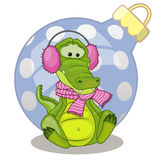 Crocodile in a fur headphones. With gift Stock Photography