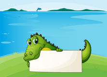 A crocodile holding an empty signboard. Illustration of a crocodile holding an empty signboard Royalty Free Stock Photos