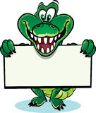 Crocodile holding sign. Cute crocodile holding up a sign. Divided into layers for easy editing royalty free illustration