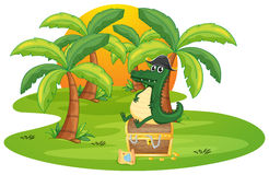 A crocodile and a jewelry box Royalty Free Stock Photos
