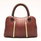Crocodile leather handbag isolated. Crocodile leather women's handbag isolated on white background royalty free stock photos