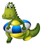 A crocodile with a lifebouy Stock Images