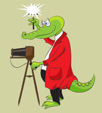 Crocodile-photographer. Cheerful crocodile in a red uniform photographs by the old camera with magnesian flash Royalty Free Stock Photo