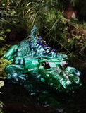 Crocodile Plastic sculpture Pet Art. Sculptures of a crocodile made of plastic bottles made by Veronika Richterova. Sculptures are installed as a part of plants Royalty Free Stock Image
