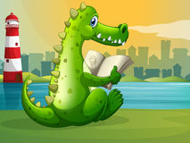 A crocodile reading across the lighthouse Royalty Free Stock Image