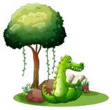 A crocodile reading beside the tree stock illustration