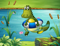 A crocodile at the river with a buoy vector illustration