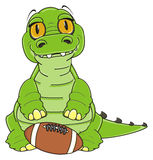 Crocodile with rugby ball Royalty Free Stock Image