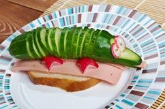 Crocodile sandwich sausage and cucumber Stock Photo