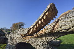 Crocodile sculpture Stock Images