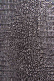 Crocodile skin leather, gray, silver background Stock Photography