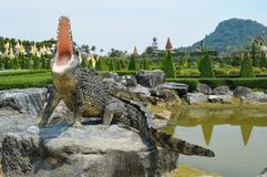 CROCODILE STATUE IN NONG NOOCH GARDEN PATTAYA Royalty Free Stock Images