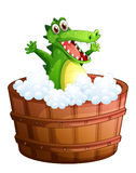 A crocodile taking a bath Stock Photo