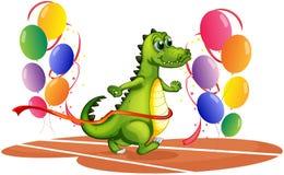 A crocodile walking between balloons Stock Photos