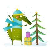 Crocodile wearing winter warm clothes celebrating holiday Stock Image