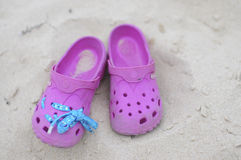 Crocs. A pair of pink crocks on the beach Royalty Free Stock Images