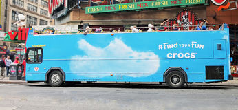 Crocs Advertisement On A Tour Bus. Advertising the popular Crocs shoes on a city sights tour bus in Manhattan, NYC Royalty Free Stock Photography