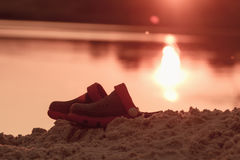 Crocs are in the sand on the shore, concept of a summer holiday stock image