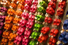Free Crocs Soft Rubber Children Sandals Hanging On A Rack Display For Sale. Colourful Sandals Of Diverse Colours Blue, Red, Pink, Green Royalty Free Stock Image - 137956616
