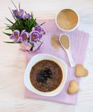 Flowers, cookies and porridge of amaranth with prunes Stock Images