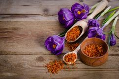 Crocus flowers and spoon with soffron Royalty Free Stock Photos
