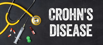 Crohn`s diseas. Stethoscope and pharmaceuticals on a blackboard - Crohn`s disease Royalty Free Stock Photography