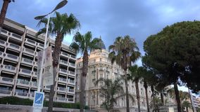 Croisette promenade in Cannes at sunset near Carlton, luxury hotel,Ultra hd 4k, real time stock video