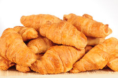 Croissant. Pile of fresh croissant on a basket Royalty Free Stock Photos