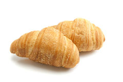 Croissant. Two fresh croissants, casting soft whadow on white. Delicious Royalty Free Stock Photo