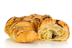 Croissant. Whole croissant and half on a white background Royalty Free Stock Image