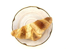 Croissant. A croissant on a white plate Stock Photos
