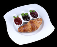 Croissant. On plate with 3 color jam royalty free stock photo