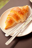 Croissant. Breakfast croissant on the plate Royalty Free Stock Image