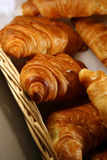 Croissant. Fresh croissant on a basket Stock Photos