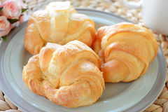 Croissant. Close-up continental breakfast with fresh croissant, coffee Stock Images